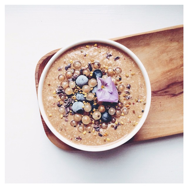 Choc (cacao, Carob, Maca) Nectarine Raw Buckwheat Porridge With White Currants, Frozen Blueberries, Cacao Nibs And Bee Pollen