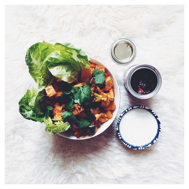 Spicy Tofu And Veggie Stew For Lunch With A Side Of Baby Gem Lettuce, Served With Fresh Coriander, Chili Flakes And Yogurt