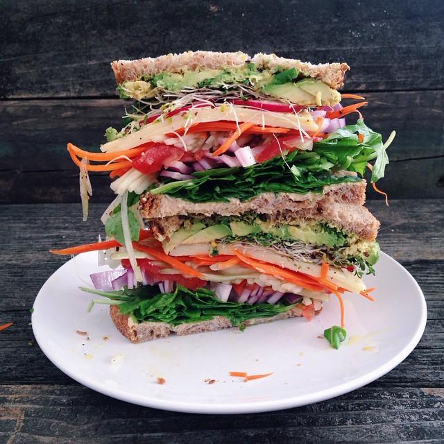 Hummus Vegetable Grain Sandwich With Arugula, Onion, Tomato, Cucumber, Carrot, Cheddar, Radish & Sprouts