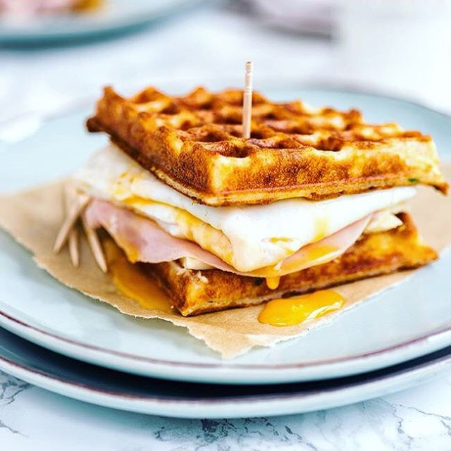 These Parmesan waffle sandwiches with egg, ham and cheese are a pretty epic way to start your day.