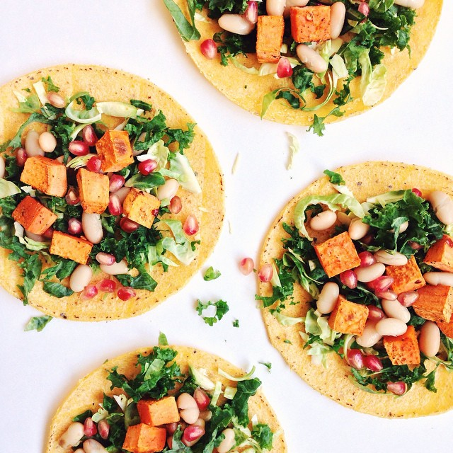 Sweet Potatoes, White Beans, Kale, Brussels Sprouts, And Pomegranate Seeds In Corn Tortillas