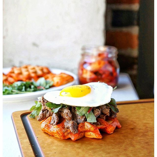 Kimchi Waffle Sandwich With A Fried Egg And Bulgogi