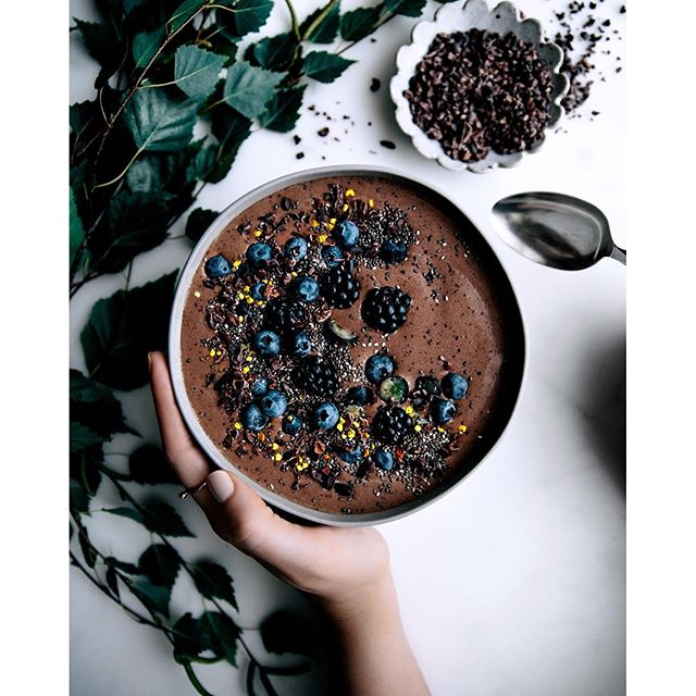 Cacao, Banana & Blueberry Protein Smoothie Bowl Topped With Chia Seeds, Cacao Nibs, Blueberries & Bee Pollen