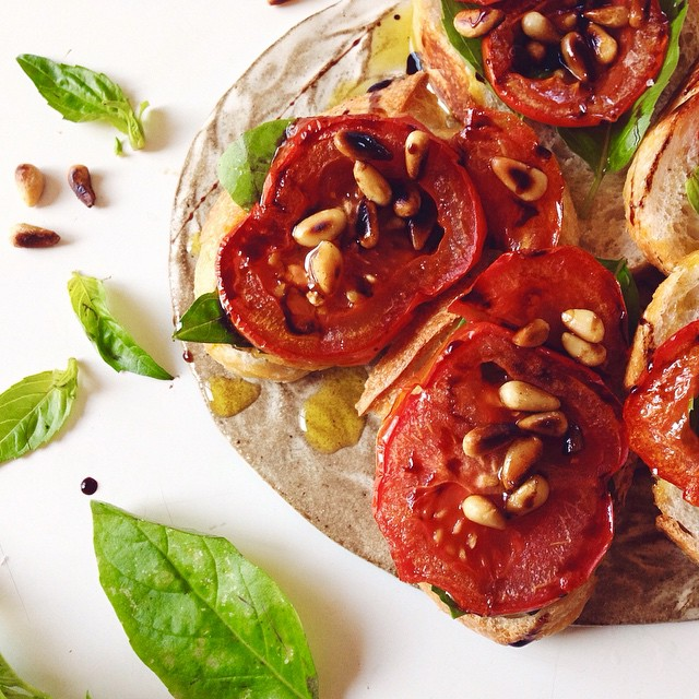 Balsamic Roasted Tomato Crostini With Toasted Pine Nuts & Basil