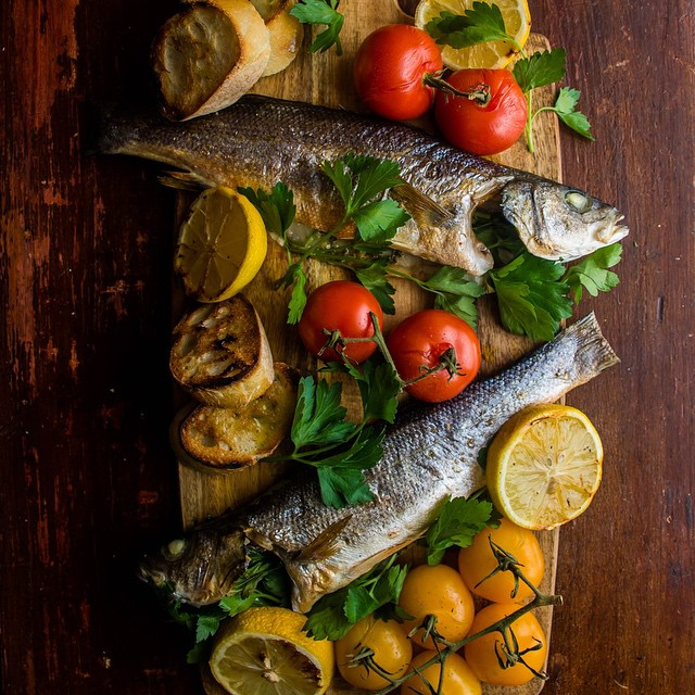 Christmas Eve things. (Wild Sea Bass stuffed with lemon/feta/parsley/basil, roasted tomatoes, &…