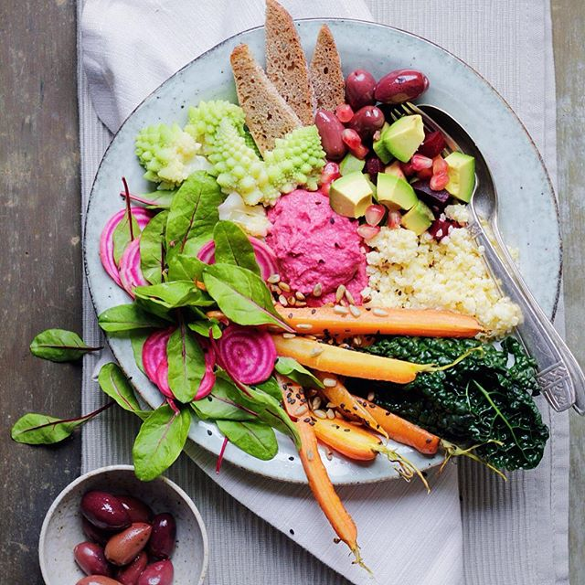 Beet Hummus Platter With Millet, Roasted Carrots, Pickled Candy Cane Beets And Kalamata Olive, Avocado And Pomegranate Salad
