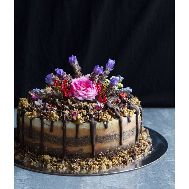 Tall and raw gaytime cake decorated with seasonal flowers for a lovely girl's 18th birthday! In…