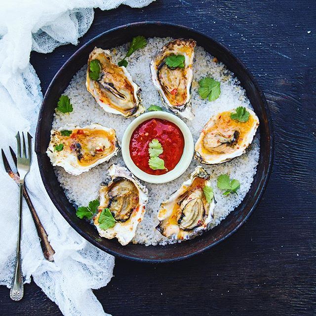 Pacific Rock Oysters in Thai Compound Butter , Fish Sauce, Sriracha, Coriander in butter, smothered…