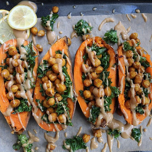 Sweet Potatoes Stuffed With Crispy Chickpeas And Kale With Tahini Drizzle