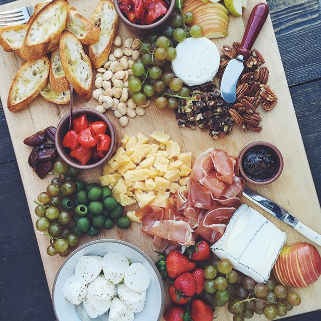 Cheese Board With Fruit, Nuts, Olives And Prosciutto