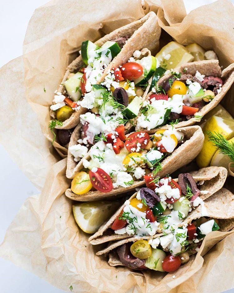 Grilled Flank Steak Pita Wraps With Garlic And Dill Yogurt Sauce, Tomatoes And Kalamata Olives