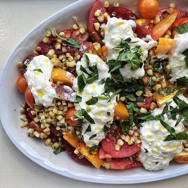 Heirloom Tomato Salad With Blistered Corn, Stracciatella Cheese And Fresh Basil