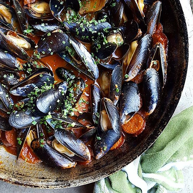 Mussels with Spicy Tomato Oil.  Easy one-dish summer dinner.  Fresh mussels steamed in a rich…