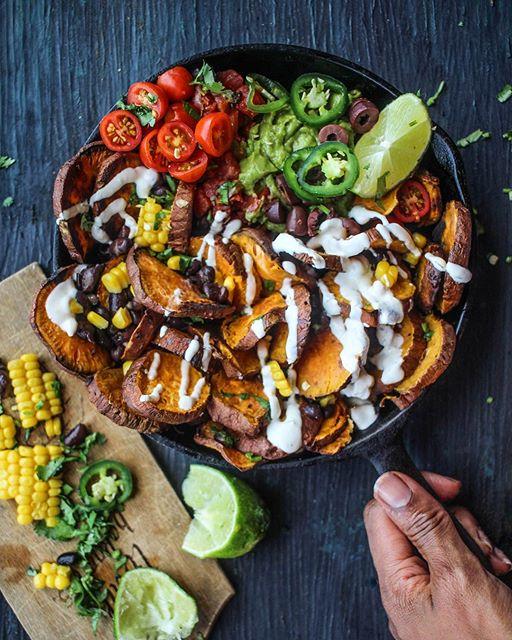 Skillet Sweet Potato Nachos With Black Beans, Corn, Jalapeños, Tomatoes And Yogurt Hummus Lime Sauce