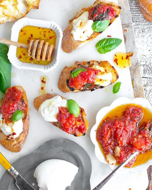 Savor the sweetness of summer tomatoes with Tomato Confit & Burrata Crostini. A fresh baguette gets…