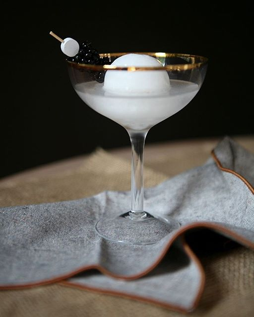 Full Moon Vodka Martini With Coconut Cream Moons And Fresh Blackberries
