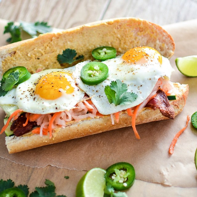 Bacon & Curry Banh Mi With Cilantro, Fried Egg & Jalapeno