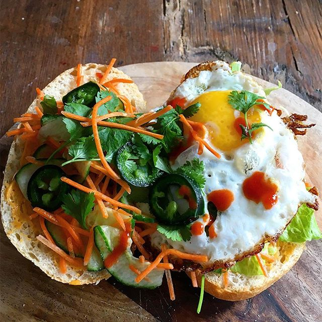 Egg Banh mi hangover sandwich. Crispy fried salty egg w/ pickled cucumber and carrots, coriander…