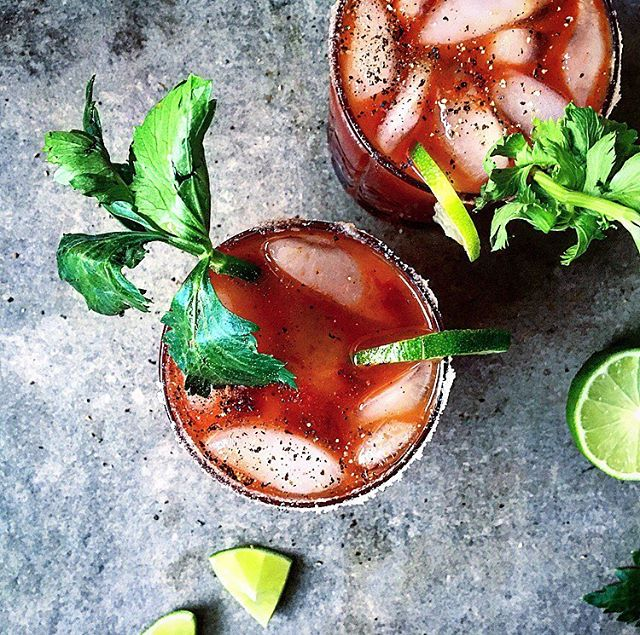 Bloody Mary's With Smoky Hot Pepper Sauce Lime And Celery