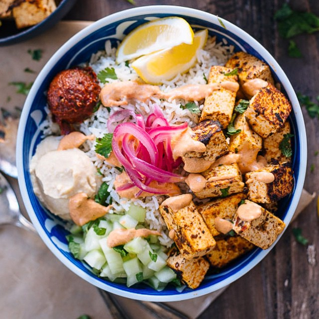 Spicy Tofu Rice Bowl With Hummus, Pickled Red Onion & Harissa Dressing