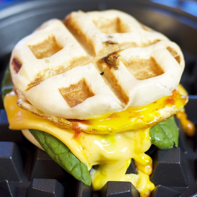 Waffled Char Siu Bao With Egg, Cheese, Spinach And Sriracha