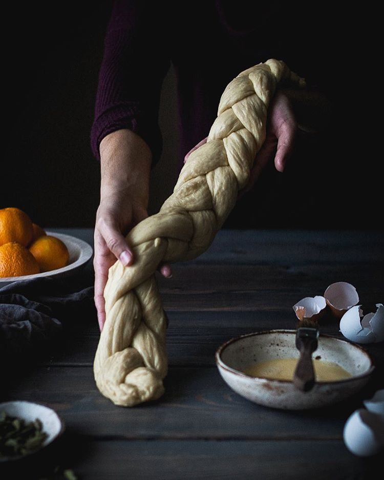 Braiding and shaping orange cardamom scented dough for a Challah Wreath.