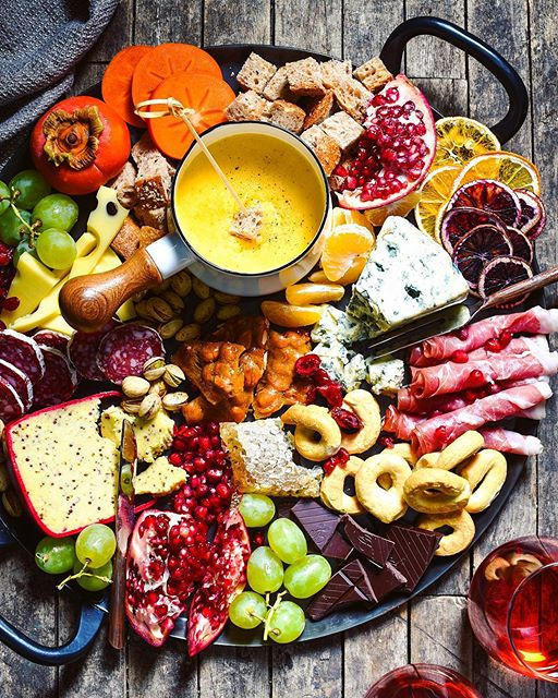 Celebrate the season with this big, beautiful platter of cheese, charcuterie, bread, seasonal fruits…