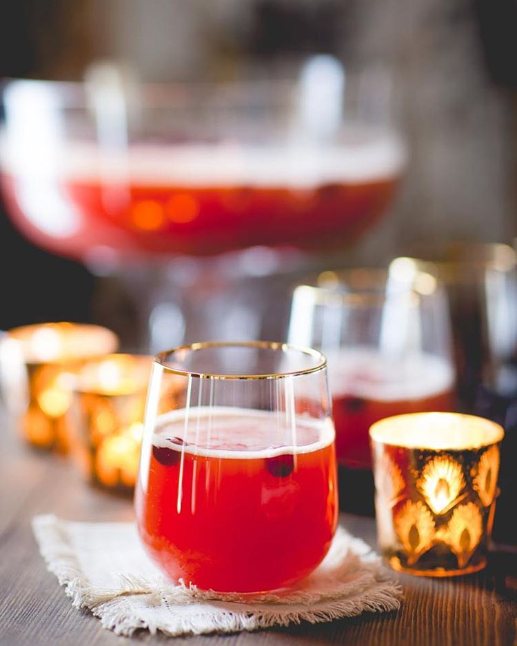 This festive holiday drink is about to rock your party punch bowl my friends! It's Maple Spiced Rum…