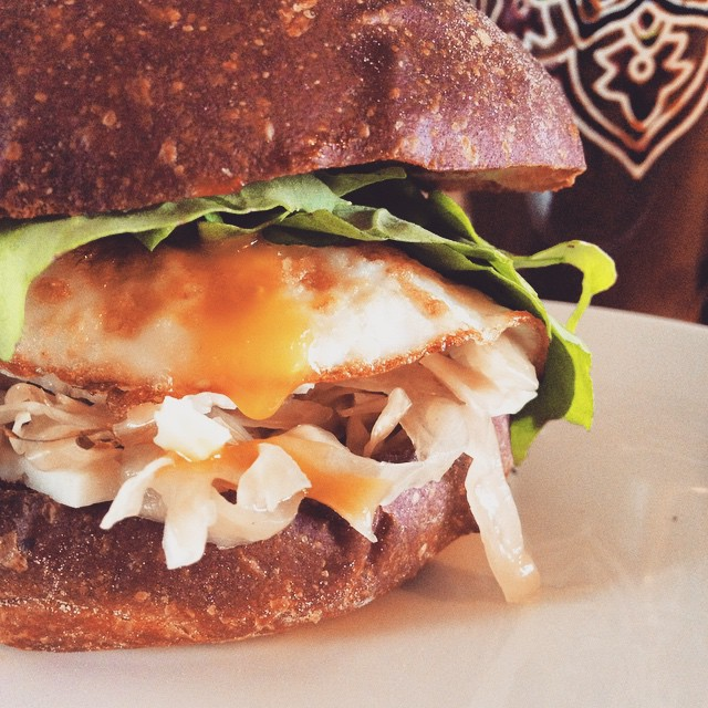 Duck Egg, Garlic Kraut And Arugula Sandwich