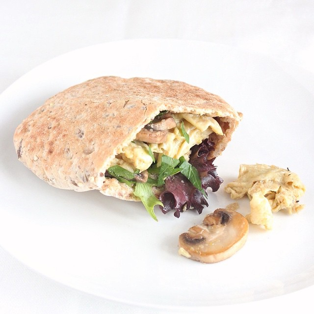 Scrambled Eggs With Mushrooms In A Pita Round Breakfast Sandwich