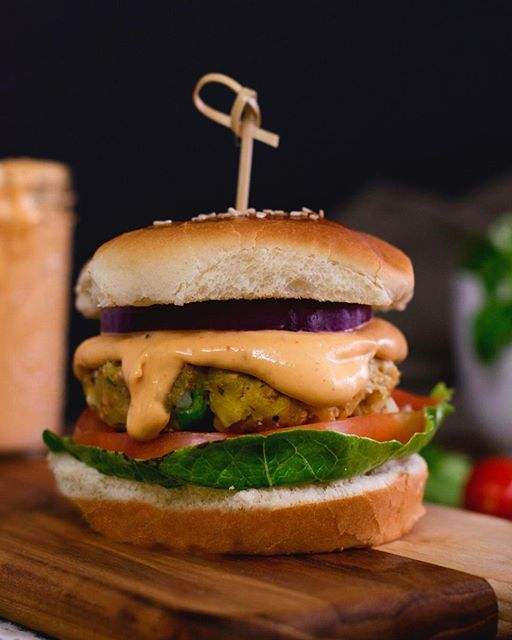 Vegan Veggie aloo tikki burger  Indian curried patty with insanely easy sauce slathered all over…