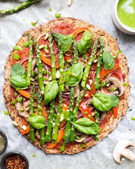 Cauliflower Crust Pizza With Spicy Tomato Sauce And Spinach Pesto