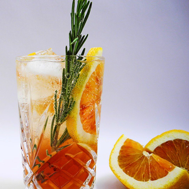 Pink Vermouth Spritzers With Orange And Rosemary