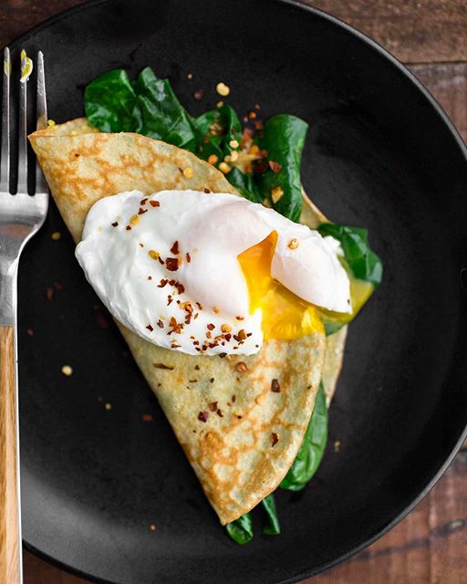 Golden cornmeal crepes stuffed with garlicky spinach and topped with a poached egg is how I…
