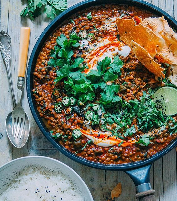 LENTIL CURRY WITH OKRA & SPINACH topped with smoked paprika oil. Served with a hot bowl of fragrant…