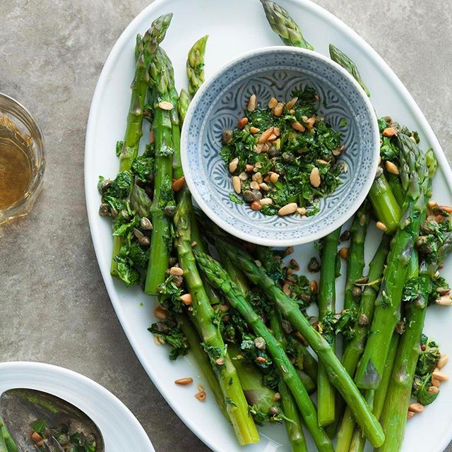 Asparagus with Caper Pine Nut Gremolata! There's nothing better than asparagus while it's in season…
