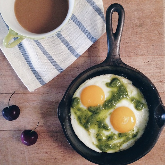 Went to sleep dreaming of breakfast, so it was skillet fried eggs drizzled in fresh pesto with a…