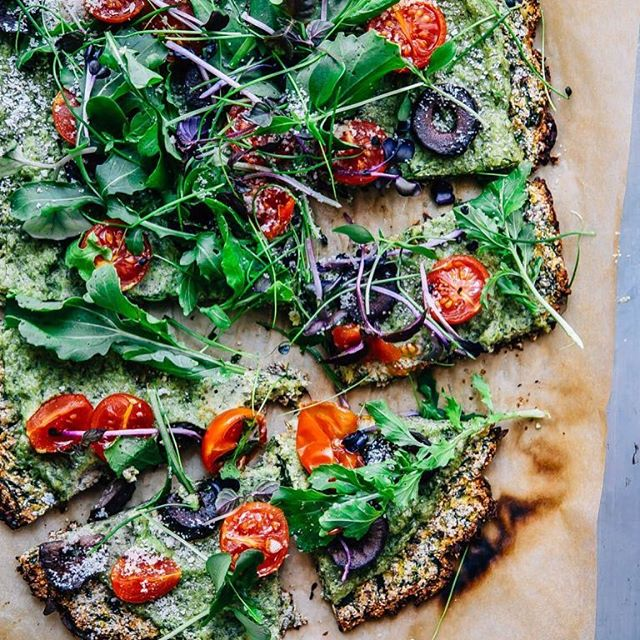 Zucchini Crust Pizza With Arugula Pesto, Cherry Tomatoes And Olives
