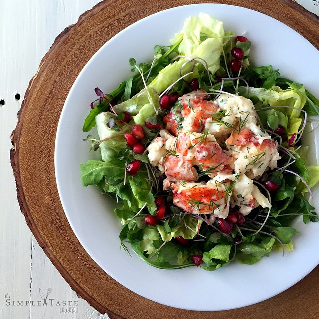 Lobster Salad With Lemon Herb Aioli On A Bed Of Fresh Greens And Pomegranate Seeds