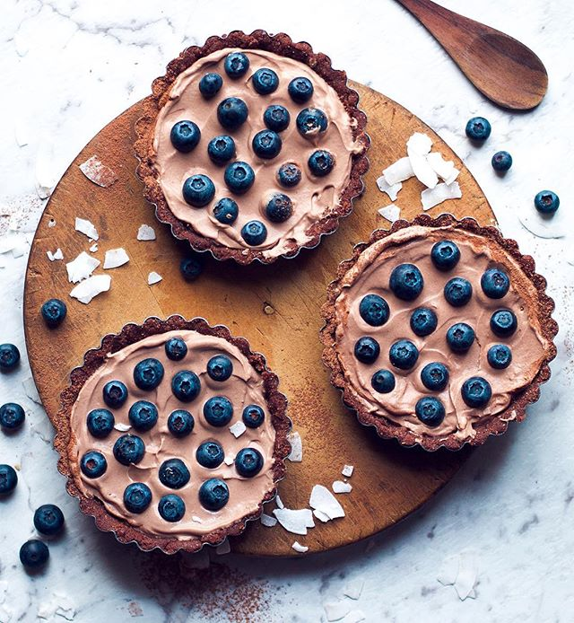 Blueberry and Chocolate coyo tarts, with Almond Brazil crust. The worlds easiest raw dessert recipe!