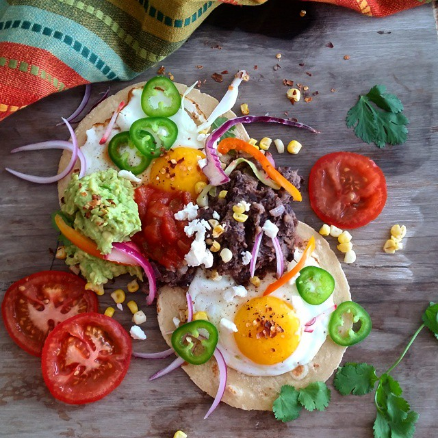 Huevos Rancheros With Guacamole And Refried Beans