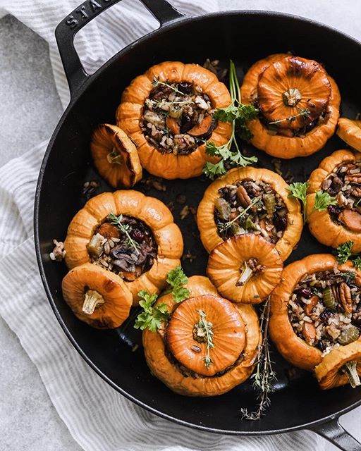 Mini wild rice stuffed pumpkins chock full of carrots, Brussels sprouts, cranberries, and pecans.