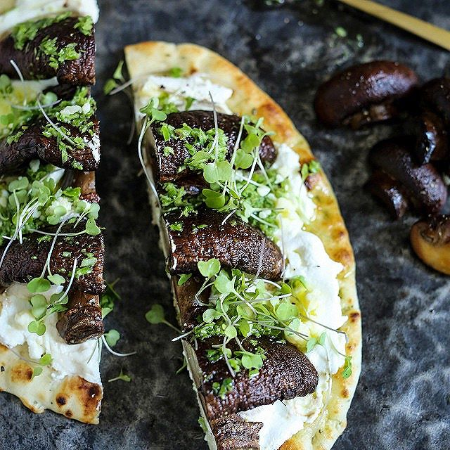 Ricotta And Roasted Mushrooms On Naan With Onion Scape Oil