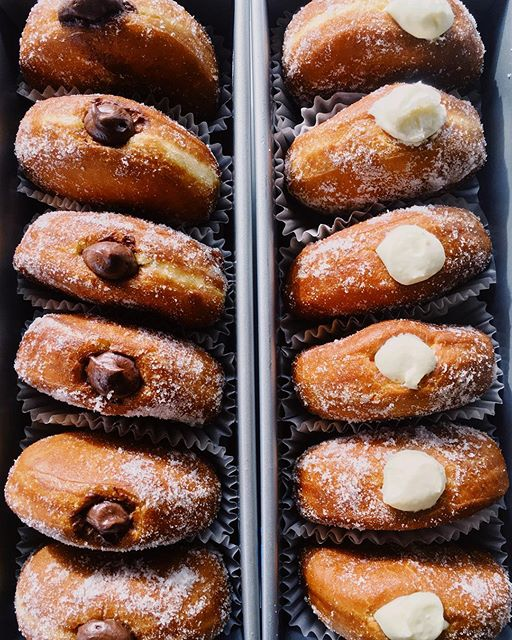 it's donut time y'all! chocolate or lemon cream!