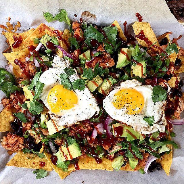 Barbeque Chicken Nachos With Avocado, Fried Eggs & Sour Cream