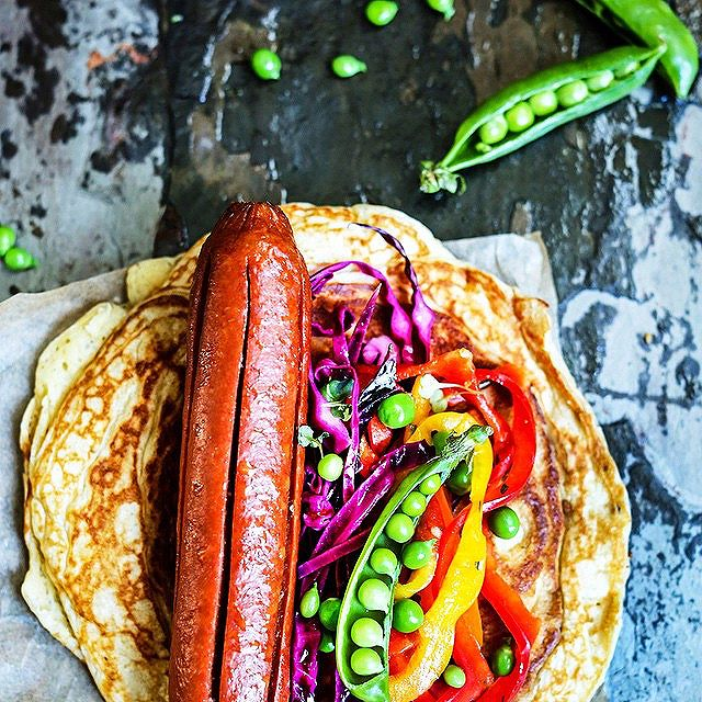 Hot Dog On Savory Pancake With Pickled Red Cabbage And Bell Pepper