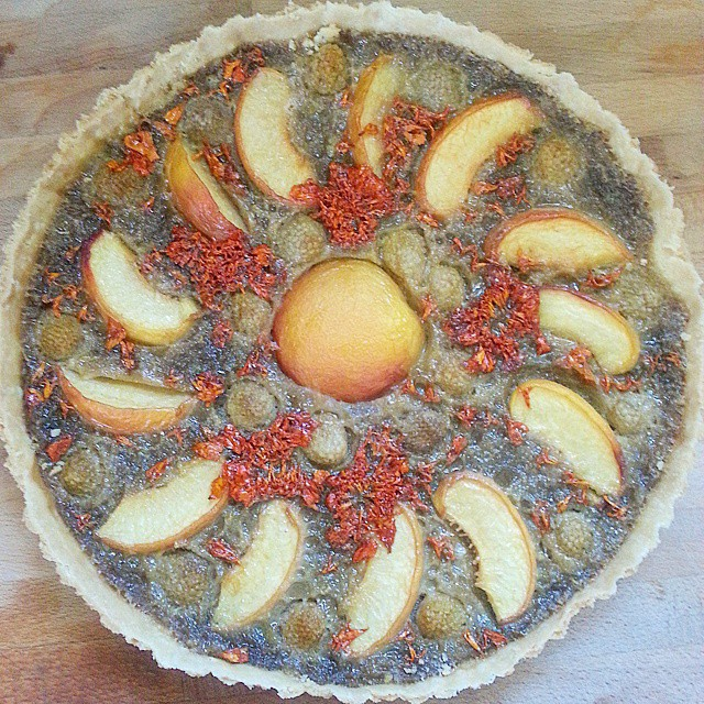 Peaches, White Raspberry And Marigold Tart With A Custard Base