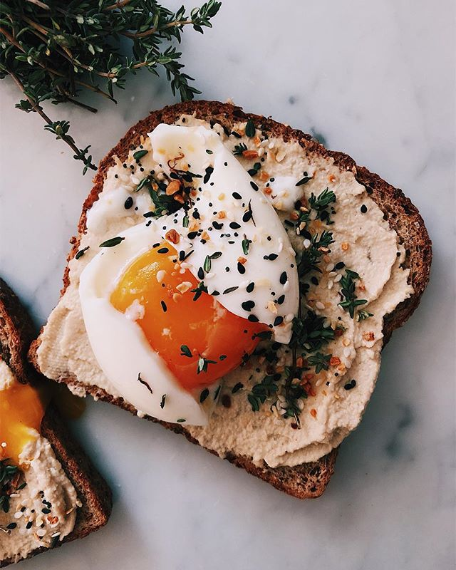 Hummus Toast With Soft Boiled Egg, Fresh Thyme And Everything Bagel Spice