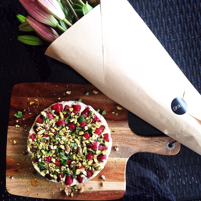 Raw Vanilla Cheesecake Topped With Pistachios, Strawberries And Mint