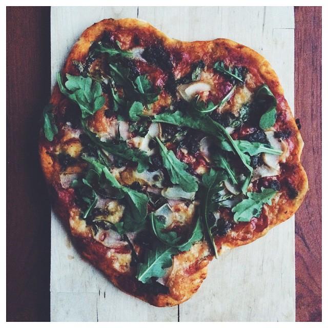 Pizza With Mozzarella, Pears, Basil Pesto & Arugula